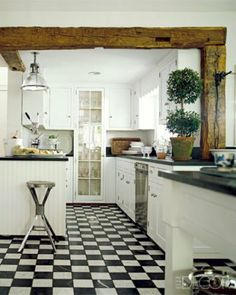 White Cottage Kitchen with Wood Beam Ceiling