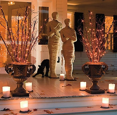 Spooky Mummy Halloween Porch - Black Urns with Orange Twinkle Lights on Sticks/Twigs