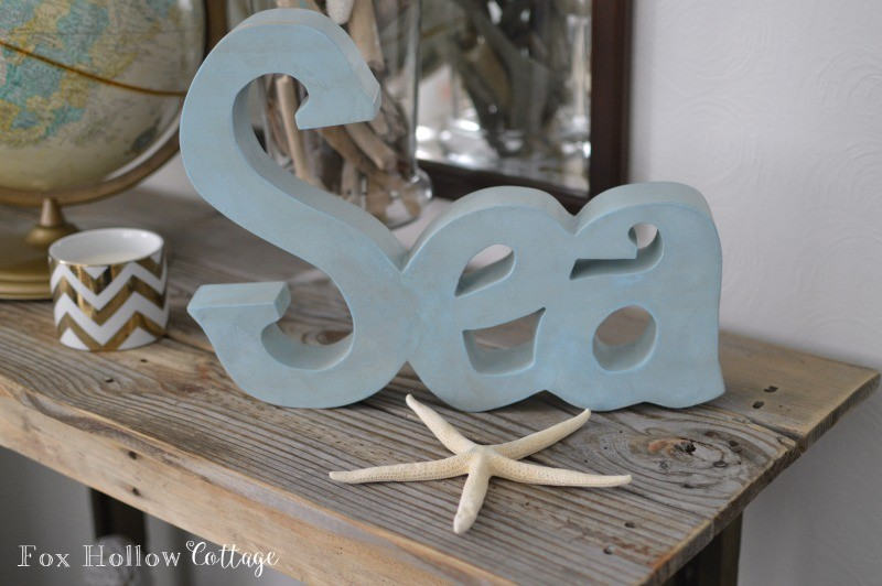 SEA coastal home decor, dual use. (sit or hangs!)  - @Homegoods Summer decorating at foxhollowcottage.com