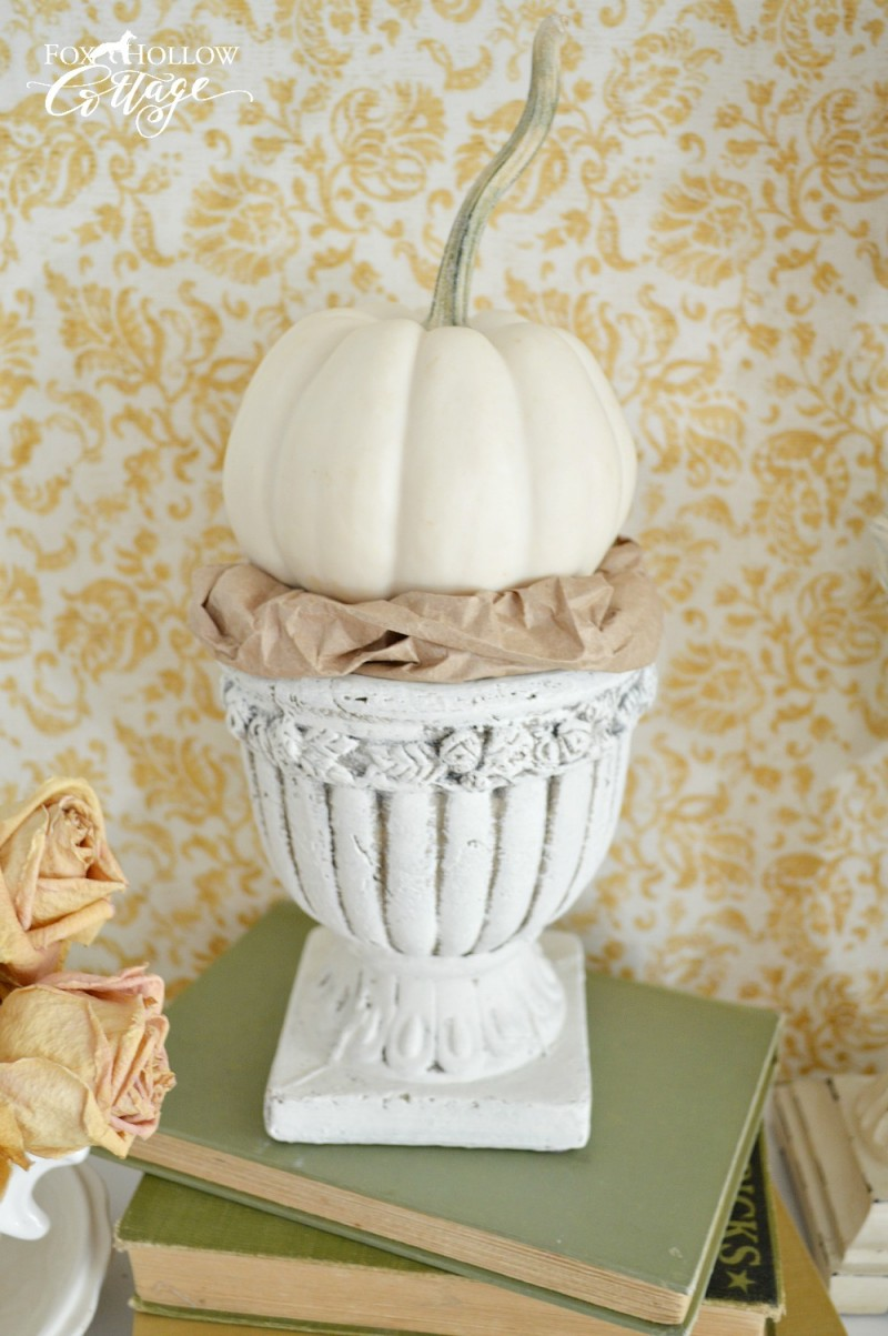 How To Make a Fabric Covered Decorating Backdrop | Fall decorating at foxhollowcottage.com | Soft neutral colors for fall. The white pumpkin in the urn, with a crumpled grocery sack for a nest is so cute!