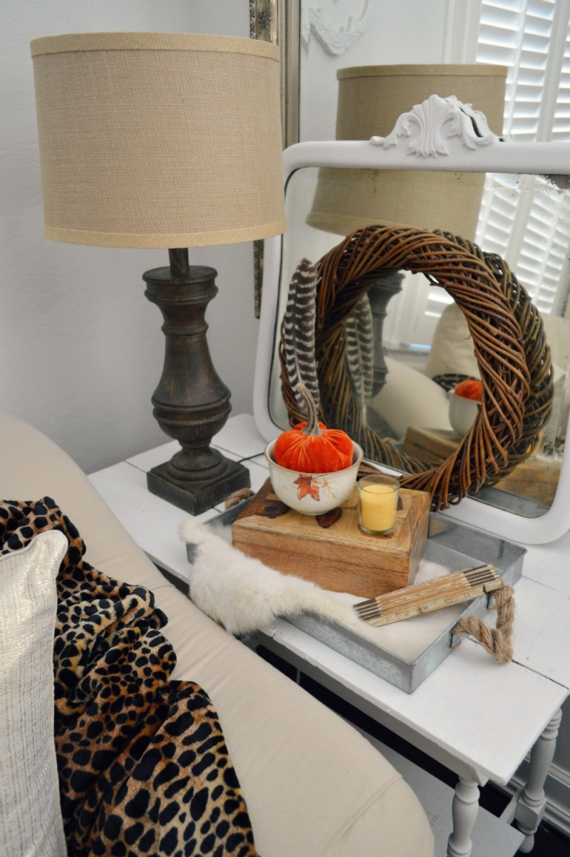 Love this chunky wood lamp (I got for a steal!) paired with a sassy, silky-plush leopard throw! The velvet pumpkin tucked in the oak leaf dish adds color and texture | @bhglivebetter @bhg #sponsored