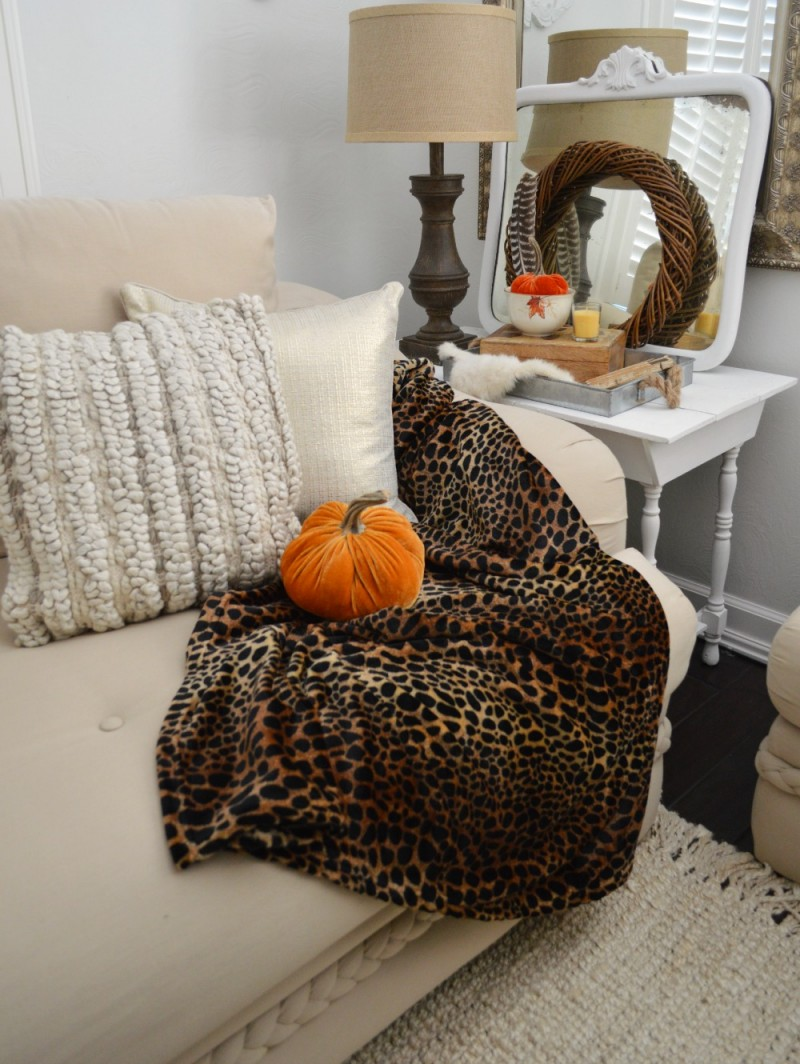 Autumn cottage decorating with Better Homes and Gardens. Fall home with neutral furnishings. The Chunky wood lamp, silky-plush leopard throw and velvet pumpkins add color & texture! #sponsored by @bhglivebetter @bhg