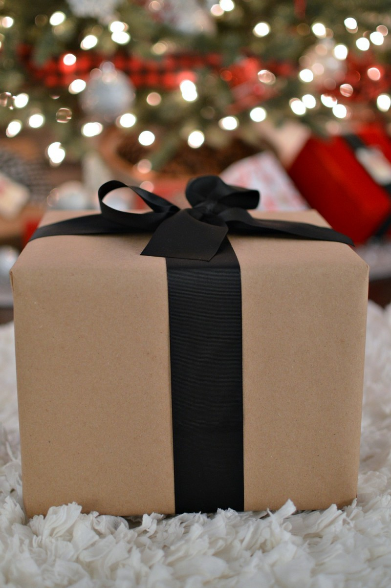 Brown paper and wide black ribbon wrapped Christmas present