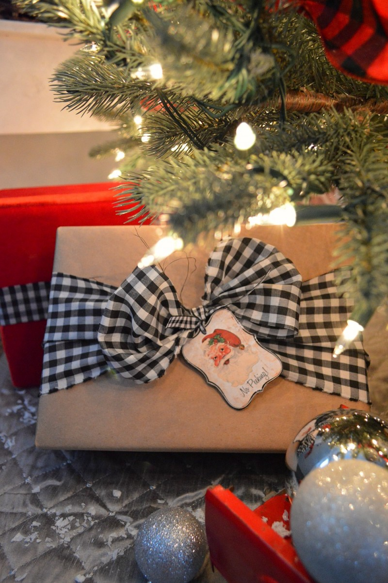 Brown paper packages with black & white checked bow and vintage santa gift tags - www.foxhollowcottage.com