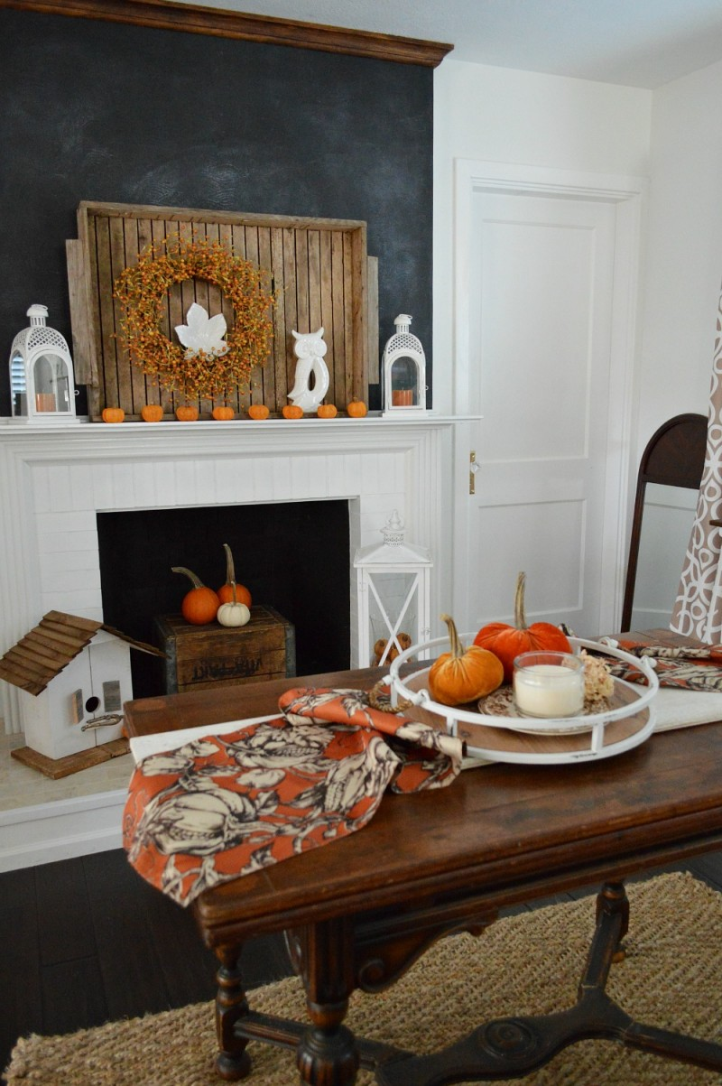 Chalkboard fireplace wall with vintage wood tray, pumpkins and vintage butterfly table. Autumn home decoarting at Fox Hollow Cottage #sponsored by Better Home and Gardens live better at Walmart | @bhglivebetter @bhg