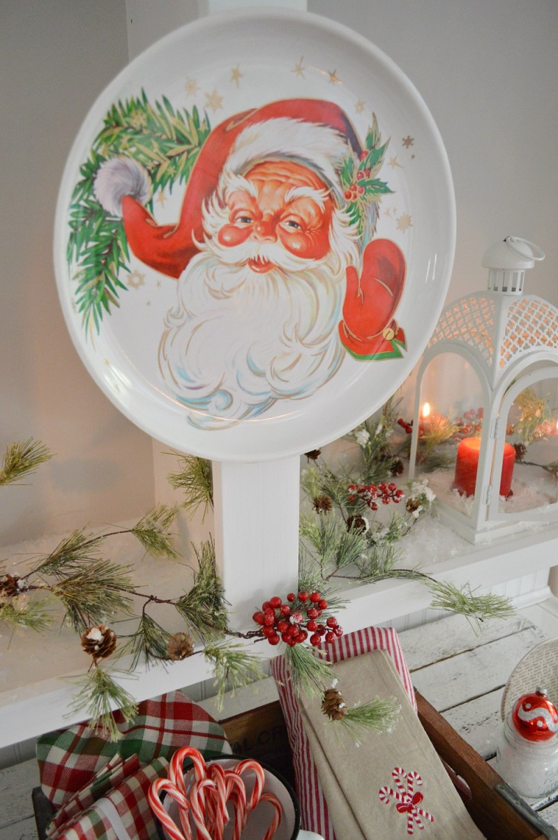 Cottage Christmas Home Tour with Country Living - Vintage Santa Serving Platter Wall Art In Open Shelves - Kitchen at foxhollowcottage.com