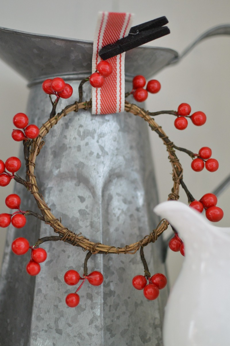 A Tiny Wreath with Ribbon on a Galvanized Pitcher. Vintage 1920's Cottage Christmas Home Tour at foxhollowcottage.com