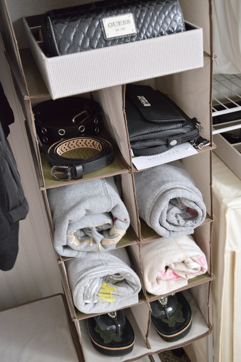 This 11 compartment vertical storage organizer holds a variety of items, while only taking p a small hanging section!