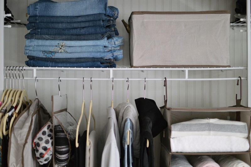 Stacking jeans leaves lots of hanging space for things like jackets and tops - Storage boxes work well on wire closet shelves.