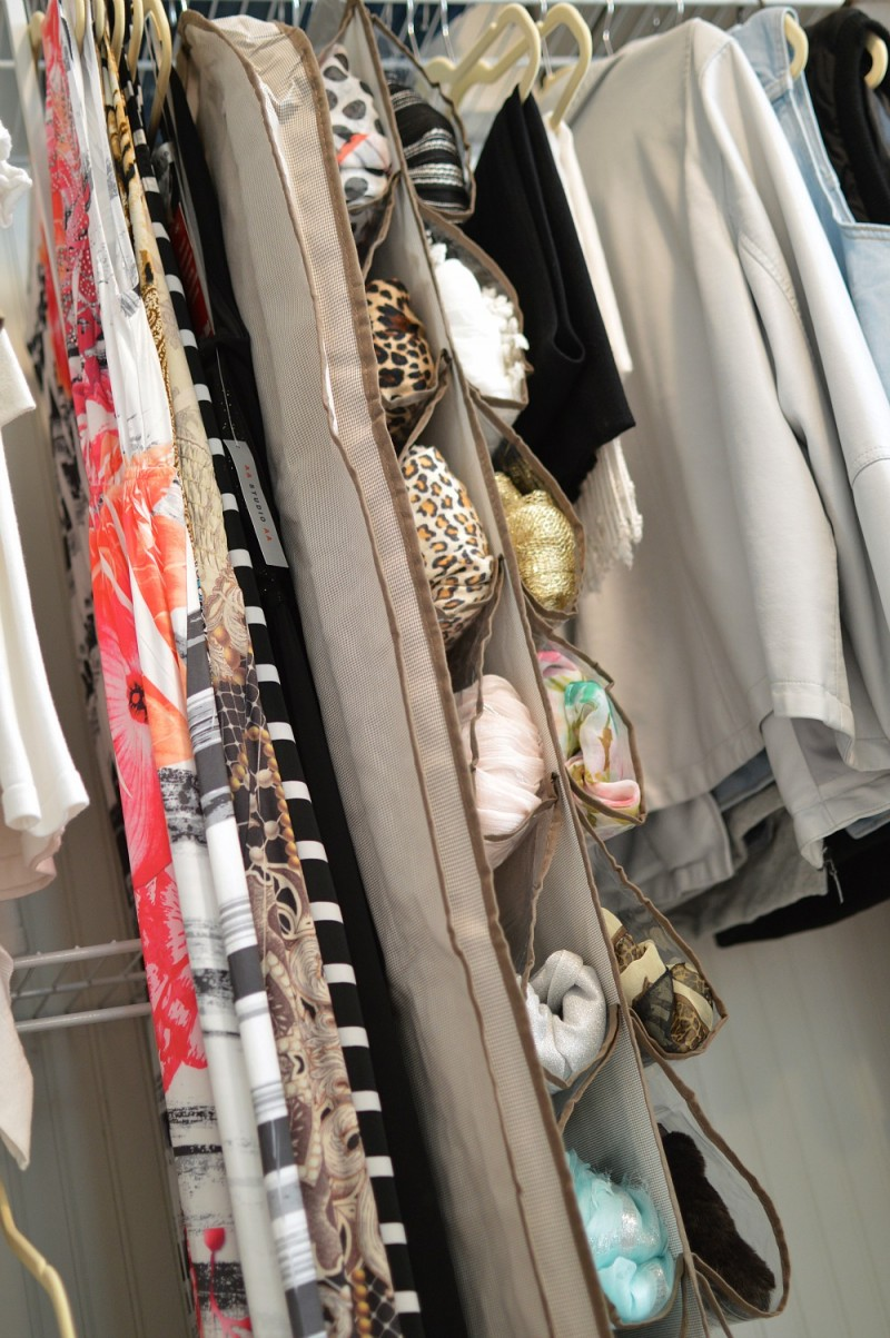 Make storage items work for you! Shoe storage doubles as scarf storage that is easy to access!