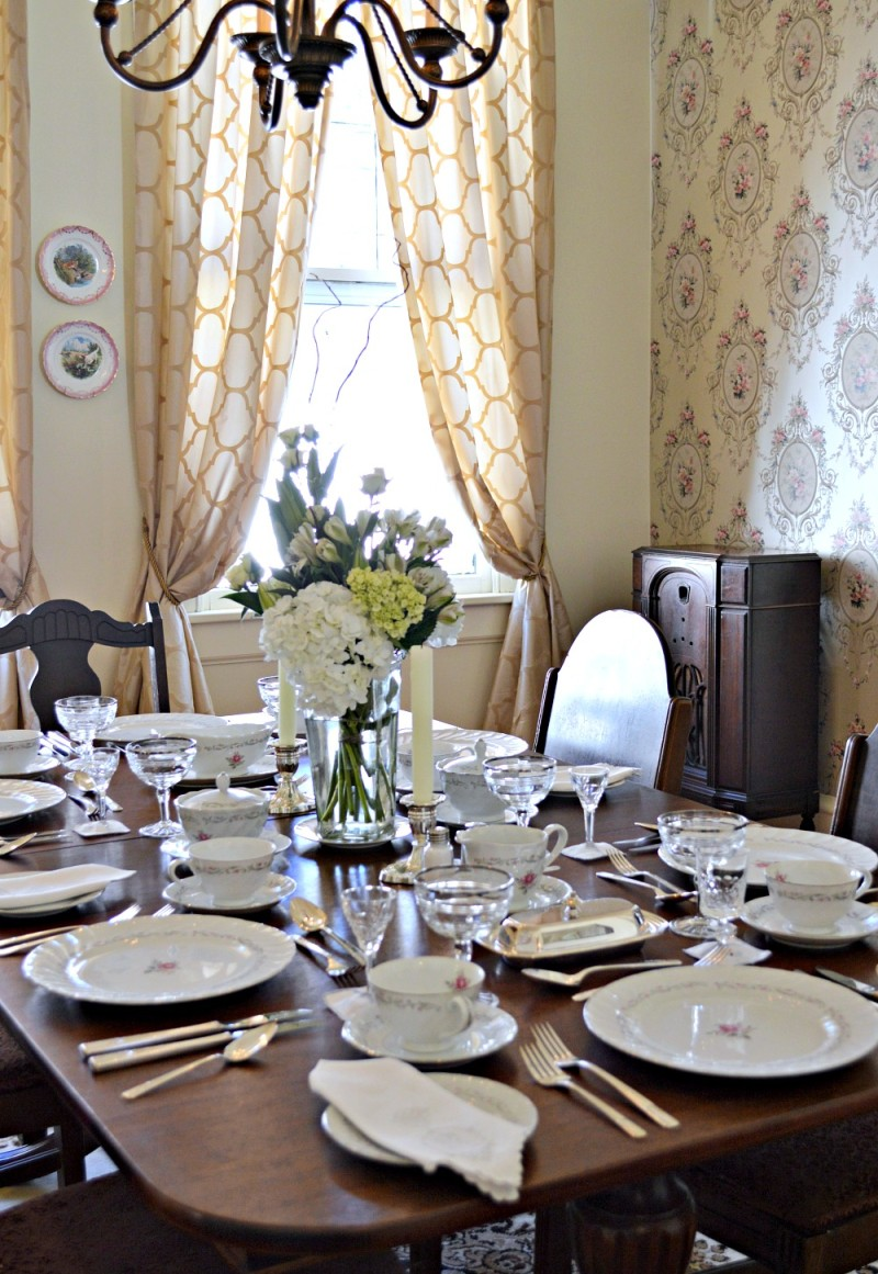 Dining room. Antique dining table and vintage inspired wall paper.