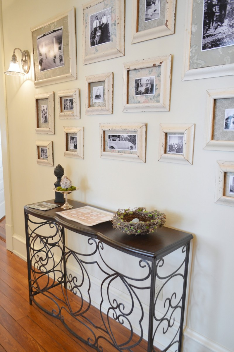 Gallery Wall. DIY salvaged wood trim frames and wallpaper matting for photgraphs.