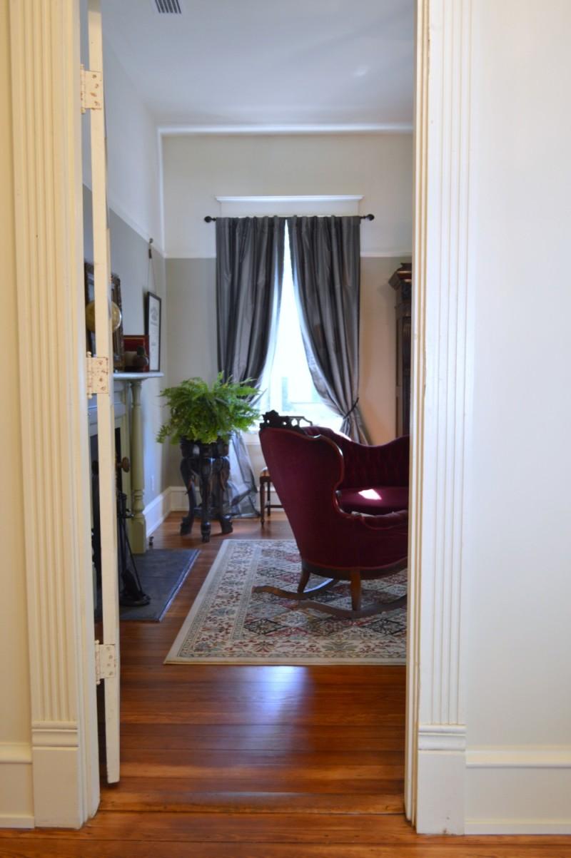 Gentlemens Parlour Sitting Room - Cigar singed velvet furnishings, original to the home.