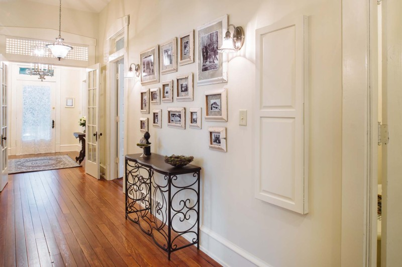 Southern Romance Fixer Upper Home Reveal - Hallway with built in ironing board and gallery wall