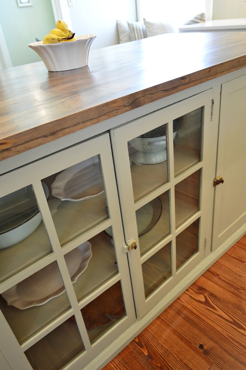 Salvaged cabinets convereted into a kitchen island in this vintage restored Southern home.