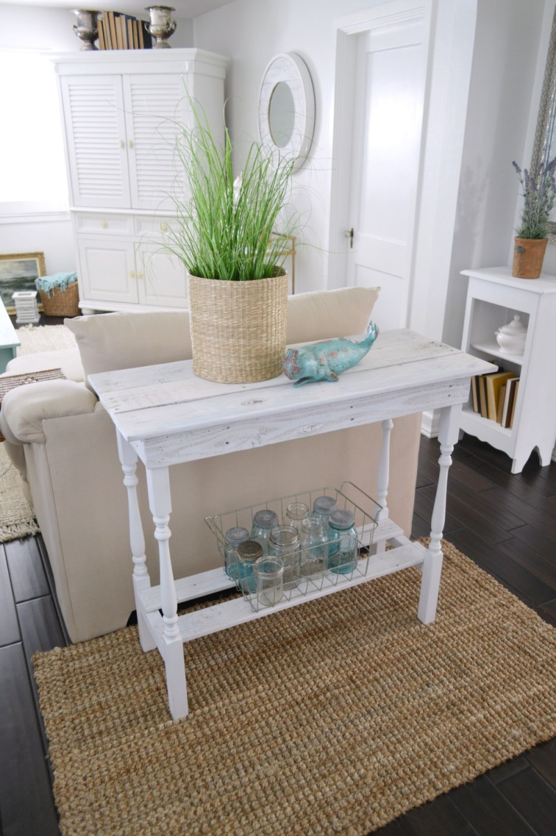 Super cute mutli-use DIY table with spindle legs and a beachy coastal style, with a white washed finish on reclaimed plallet wood.