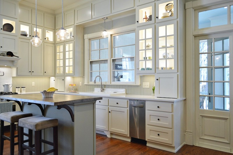 Vintage Kitchen Makeover Reveal - White floor to ceiling cabinets, quartz counters, repurposed island, vintage restored enamel farm sink, gas range, pot filler, wood floors.