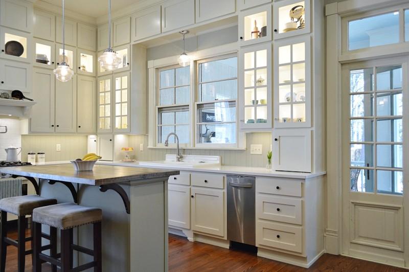 Vintage Kitchen Makeover Reveal - White floor to ceiling cabinets, quartz counters, repurposed island, vintage restored enamel farm sink, gas range, pot filler, wood floors.