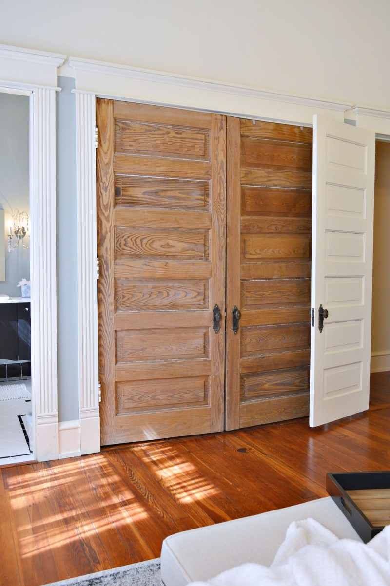 Vintage home with original wood panel doors as double closet doors. Phantom Screens Southern Romance home renovation project.