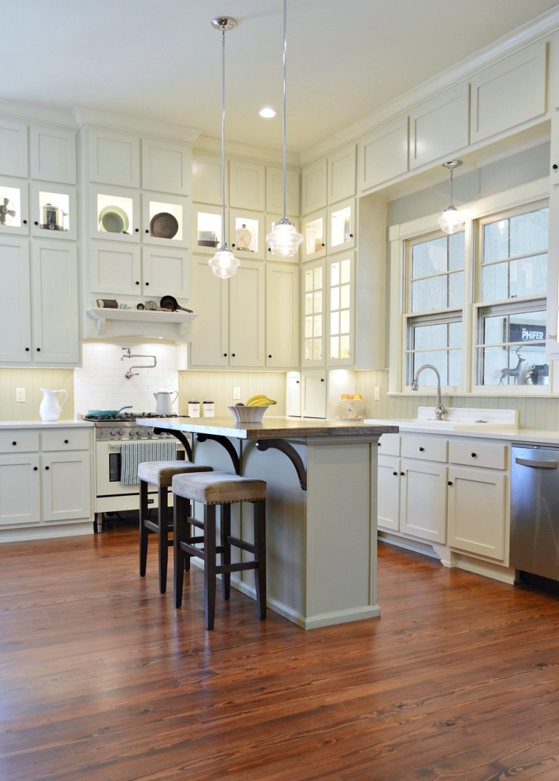 White Kitchen - Wood Floors - Vintage enamel sink with built-in drain board - Southern Romance renoveated Phantom Screens idea house