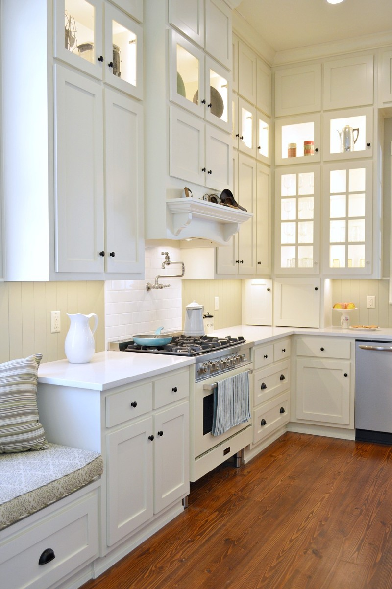 White kitchen with floor to ceiling cabinets - Newly restored, vintage Southern Romance House, a Phantom Screens idea house.