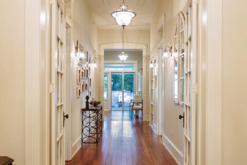 hallway - restored wood floor transition to new florring in the kitchen