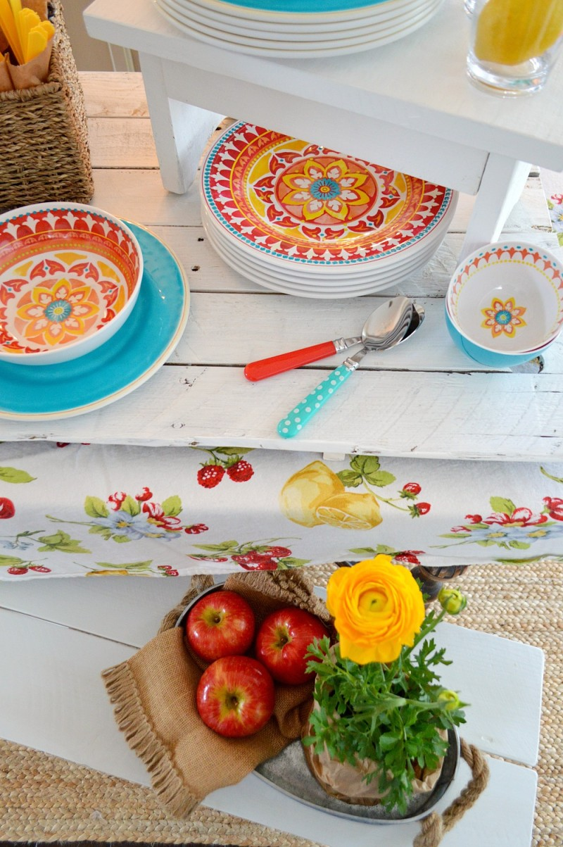 Bright red, yellow + turquoise plates & bowls, in no-worry melamine - For more ideas visit foxhollowcottage.com - How to host an indoor/outdoor BBQ party