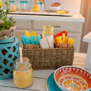 Quick affordable outdoor in BBQ dinner party ideas - Use a divided basket or caddy to hold utencils, napkins and etc's