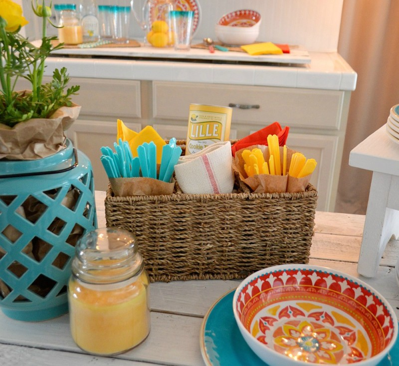 Quick affordable outdoor-in BBQ dinner party ideas - Use a divided basket or caddy to hold utencils, napkins and etc's