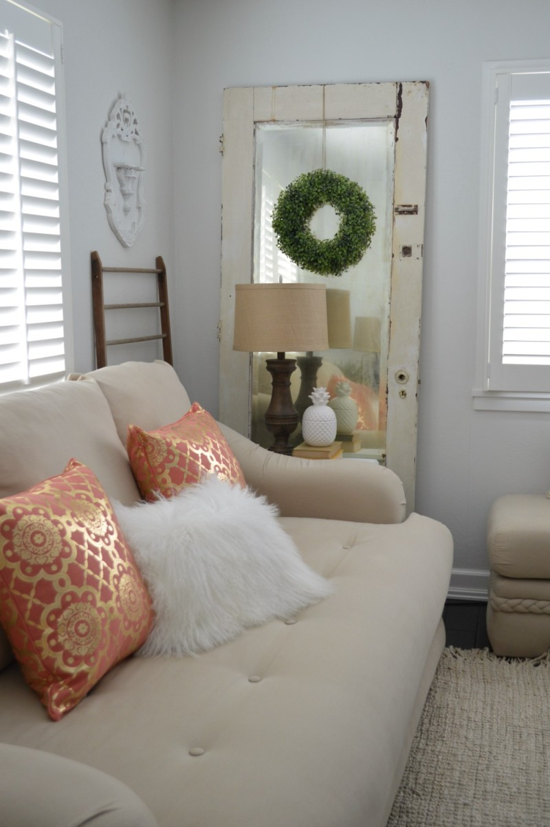 Spring Cottage Living Room at foxhollowcottage.com - Vintage mirrored door, boxwood wreath, chunky wood lamp.