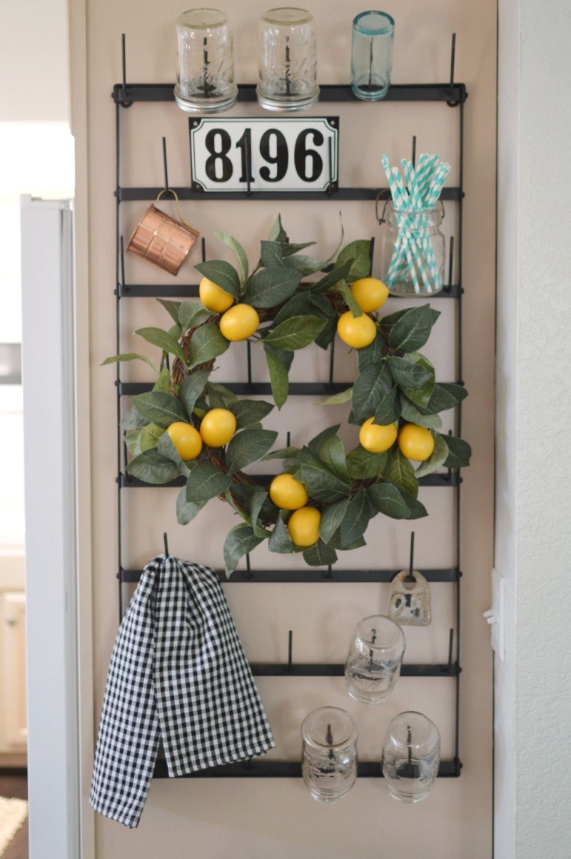 Cottage Kitchen Vintage bottle rack, lemon wreath paper straws old bar jars.