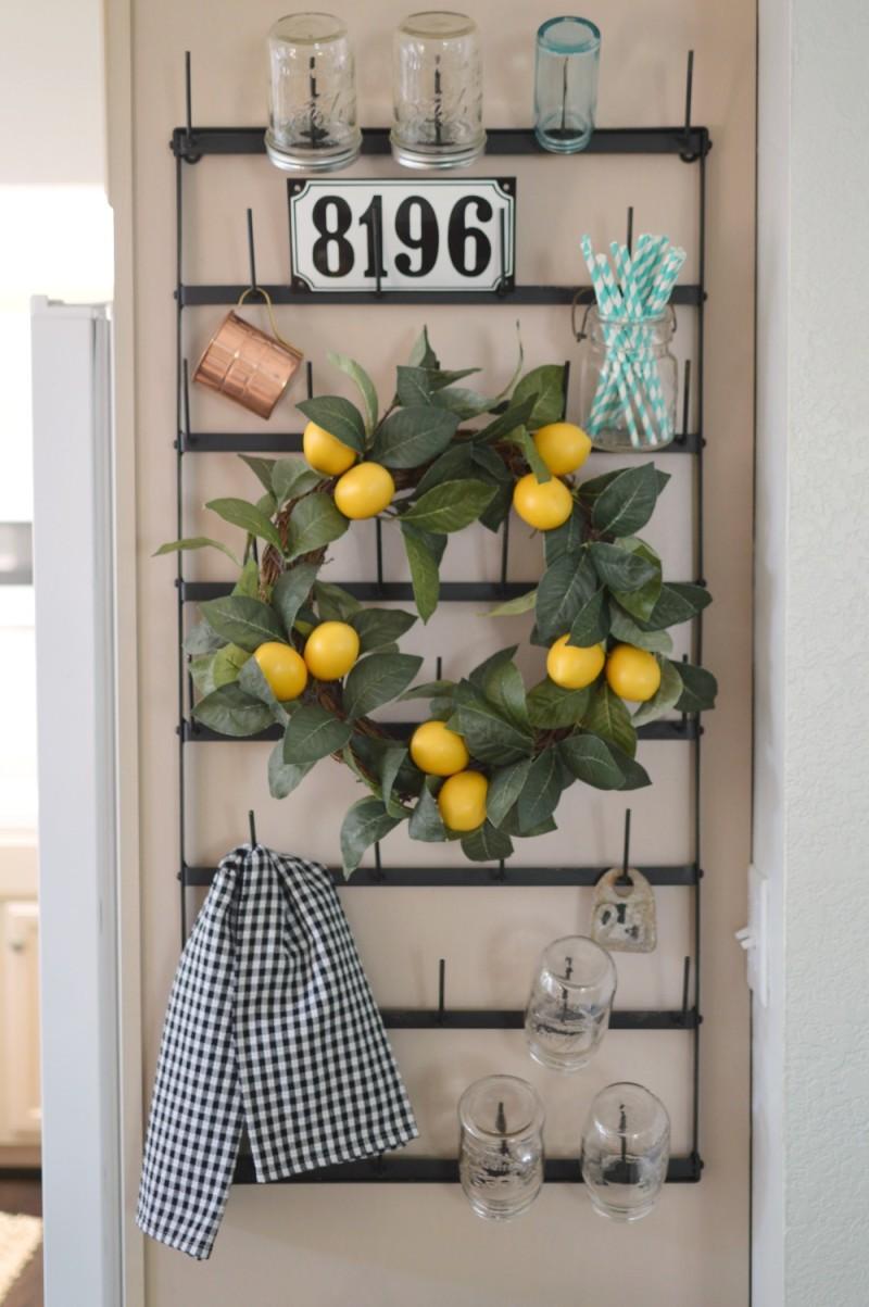 Cottage Kitchen Vintage bottle rack, lemon wreath paper straws old bar jars.