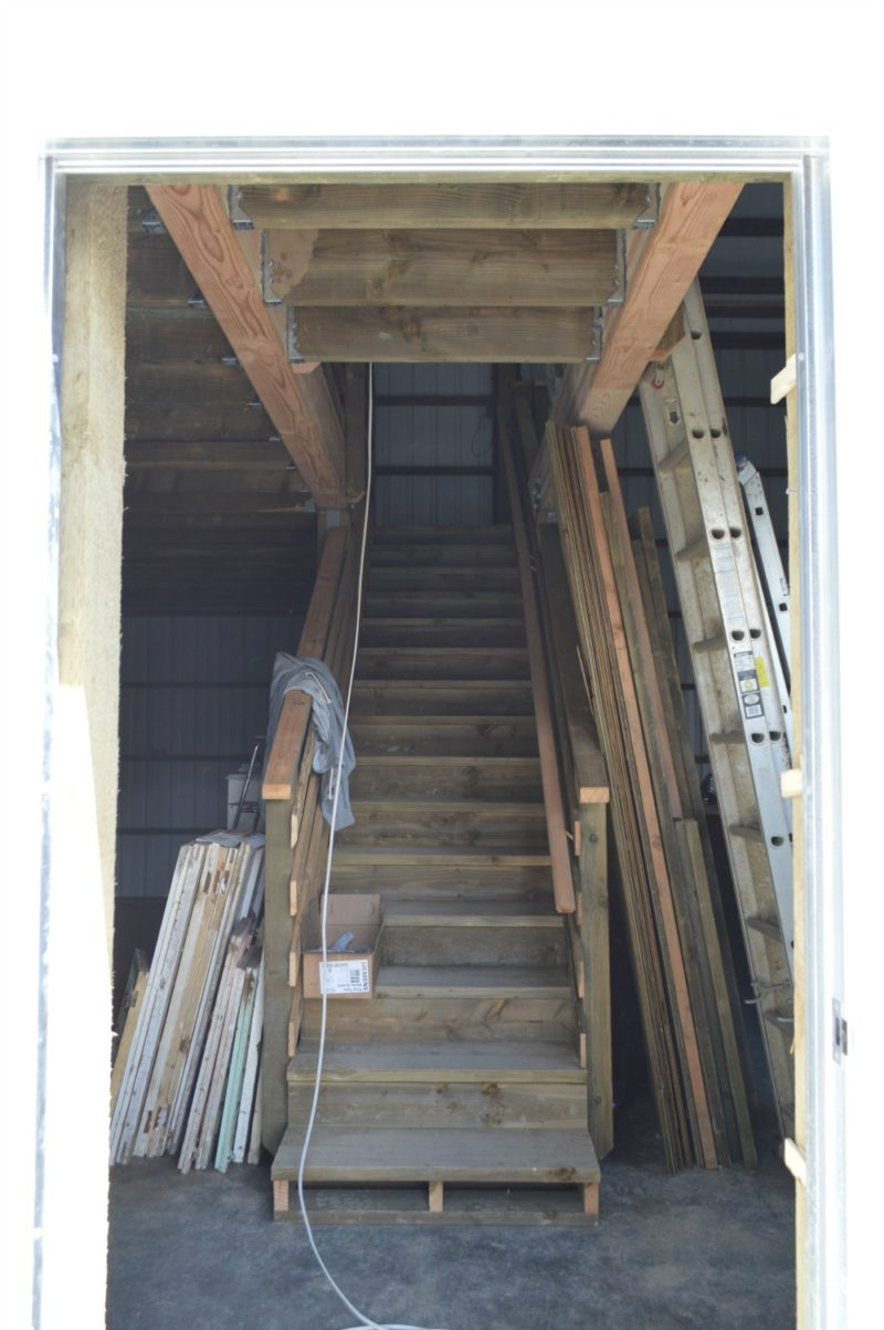 Fox Hollow Cottage Workshop - Metal Pole Building - the man door opens into the stairs, for putting junk hauls straigt into storage.