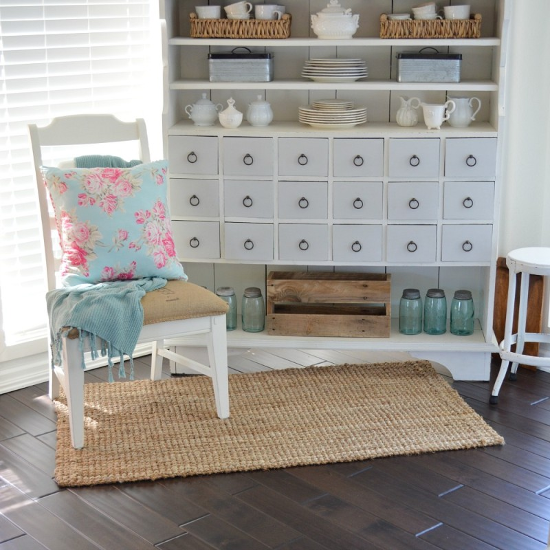 Spring Cottage. Sun room, apothecary cabinet, aqua floral pillow - foxhollowcottage.com - Fox Hollow Cottage blog