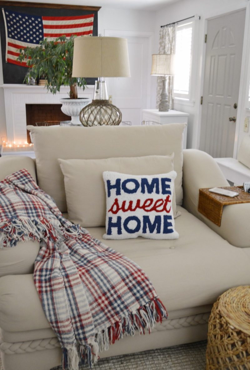 Home-Sweet-Home red, white and blue pillow, plaid Ralph Lauren throw, and a big cozy chair!