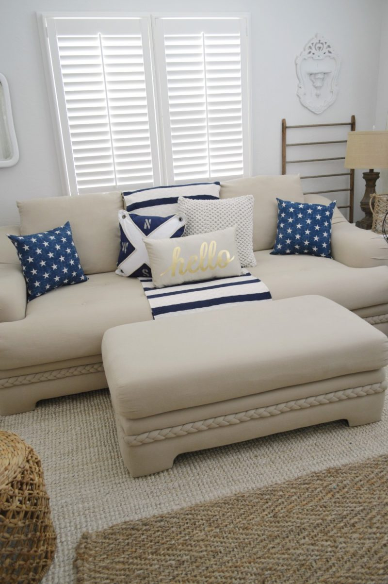 Neutral sofa with navy, nautical, stars and HELLO pillows