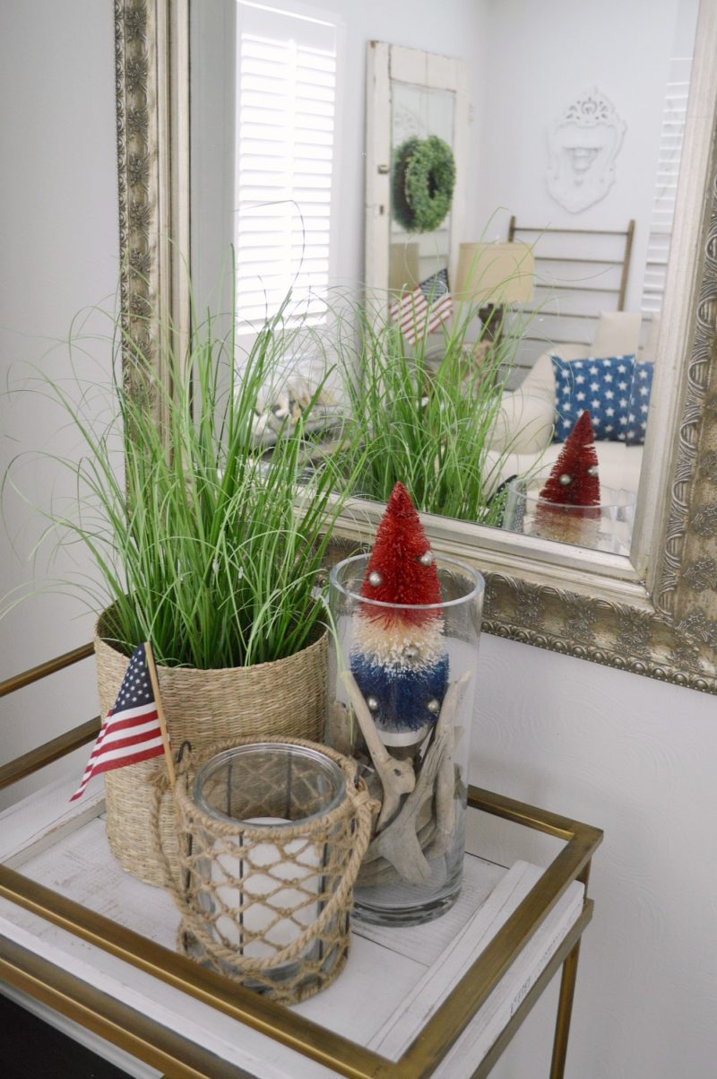 Patriotic nautical decor. Sea grass, driftwood, vintage bottle brush tree in red, white and blue.