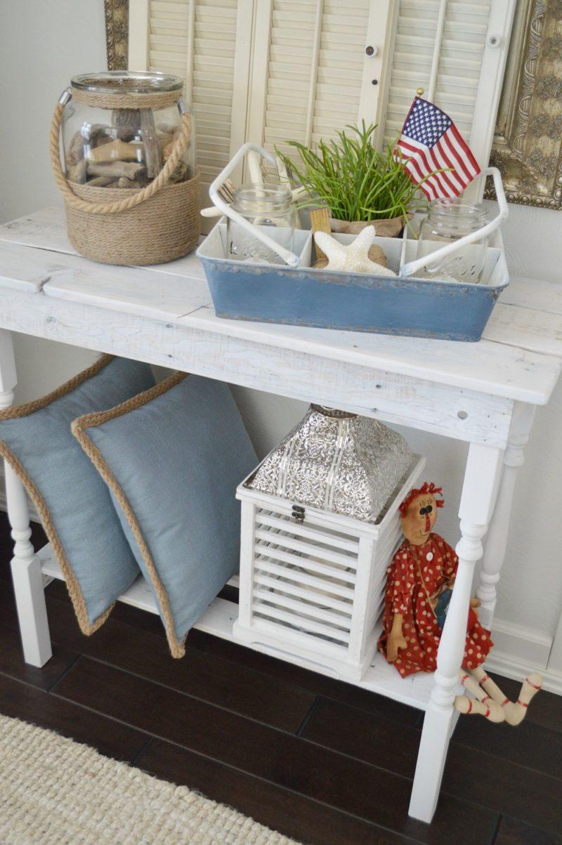 Rustic coastal cottage home decorating - DIY white wood table - Lantern, Rope Trim Pillows, Raggedy Ann