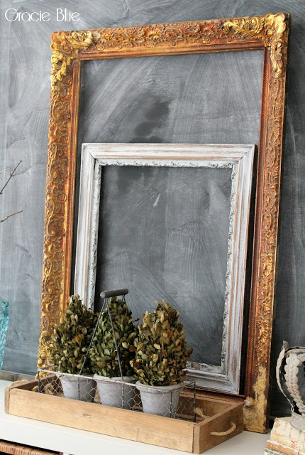 Layered frames on chalkboard wall. Gracie Blue