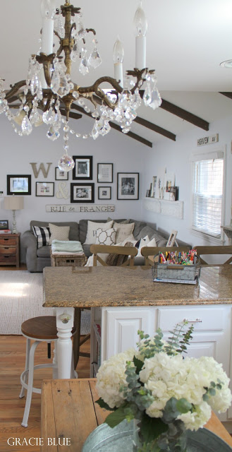 Farmhouse Living Room. Vaulted ceiling with wood beams, gallery wall. Home Tour at foxhollowcottage.com - Gracie Blue