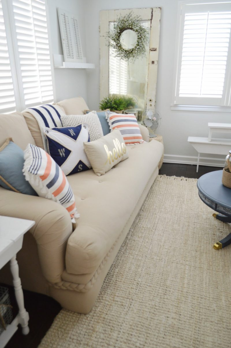 Neutral Navy Living Room Refresh - casual summer navy coral Target pillows