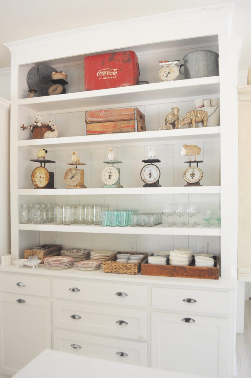 Farmhouse home tour. Apothecary cabinet with vintage scale collection. Life on the Shady Grove