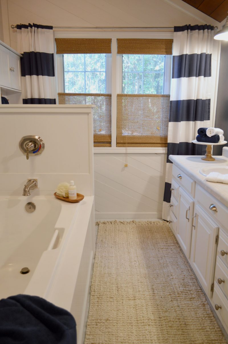 Navy Bathroom Budget Breakdown and Shopping Sources - Blue & White Cottage Bath with Coastal Vibe and Natural Woven Rug, Blinds.