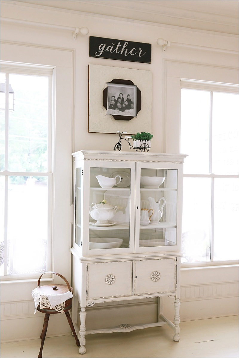 Life On The Shady Grove White Farmhouse Home Tour at Fox Hollow Cottage. White Glass China Cabinet and Gather Sign