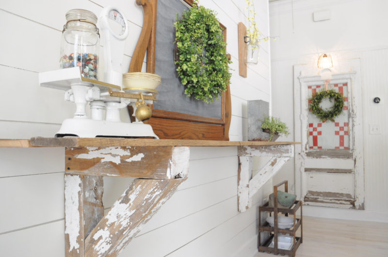 "Love the reclaimed wood shelf brackets on the ""buffet"" shelf in this farmhouse dining room! A vintage scale and old dresser mirror turned chalkboard complete the vignette. Life on the Shady Grove"