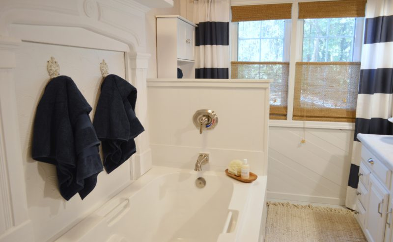 Navy Bathroom Budget Breakdown and Shopping Sources - White cottage wood wrapped tub