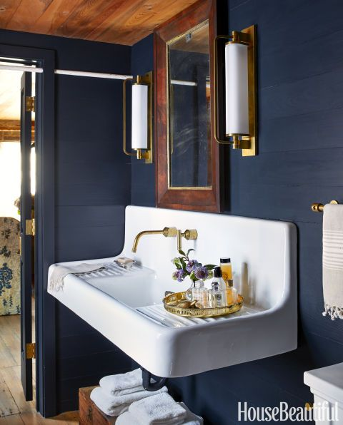 Navy Bathroom Decorating Ideas: Vintage farm sink, wood ceiling and blue painted wood walls. House Beautiful.