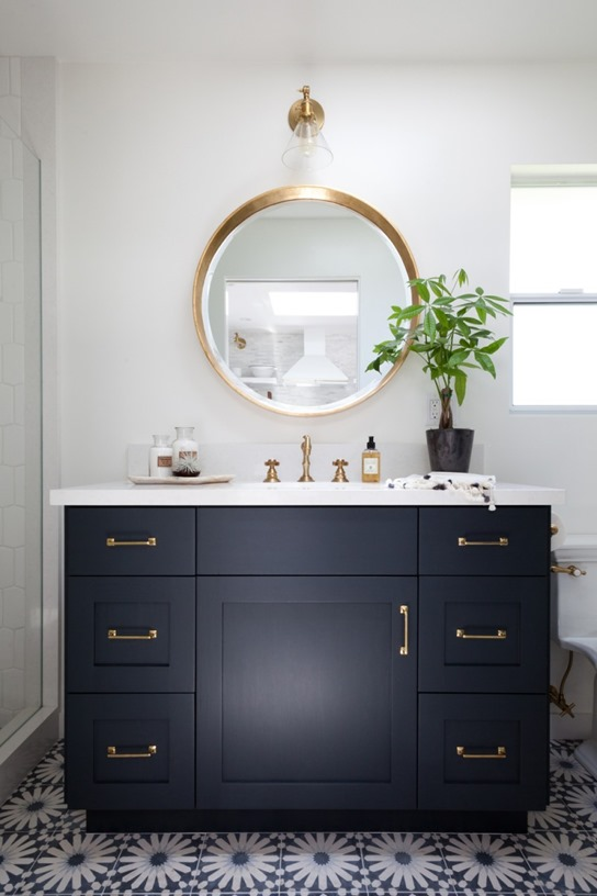 Navy Bathroom Decorating Ideas: Deep Navy Blue Vanity Cabinet with Cement tile floor, Gold accent mirror and light fixture. By Amy Bartlam