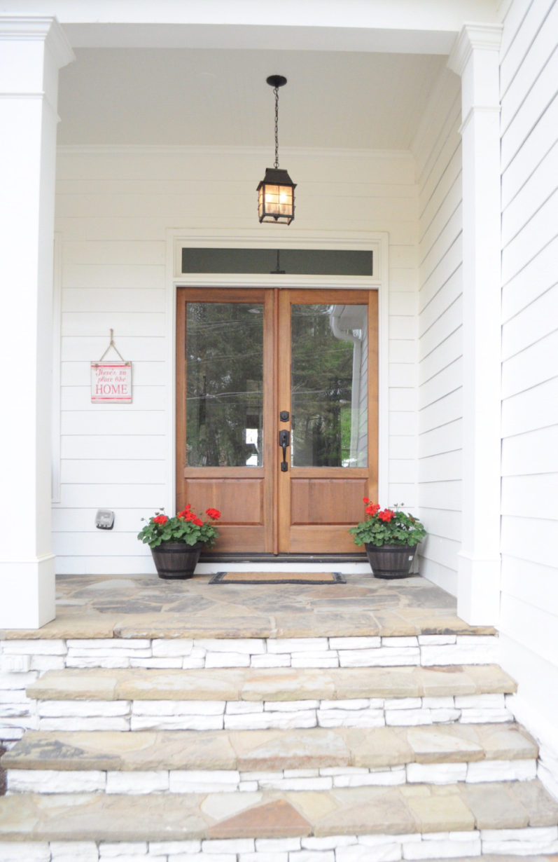 Life On The Shady Grove White Farmhouse Home Tour at Fox Hollow Cottage. Featuring mid-tone wood and glass double doors and stone steps