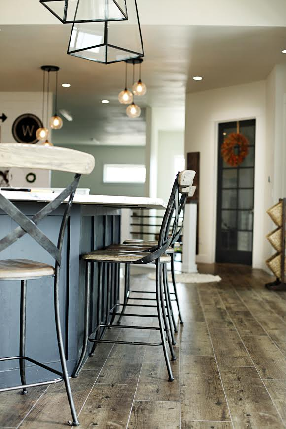Custom Built Modern Farmhouse Home Tour with Household No 6 | Kitchen great room. Black island, wood metal bar stool seating, wood floor